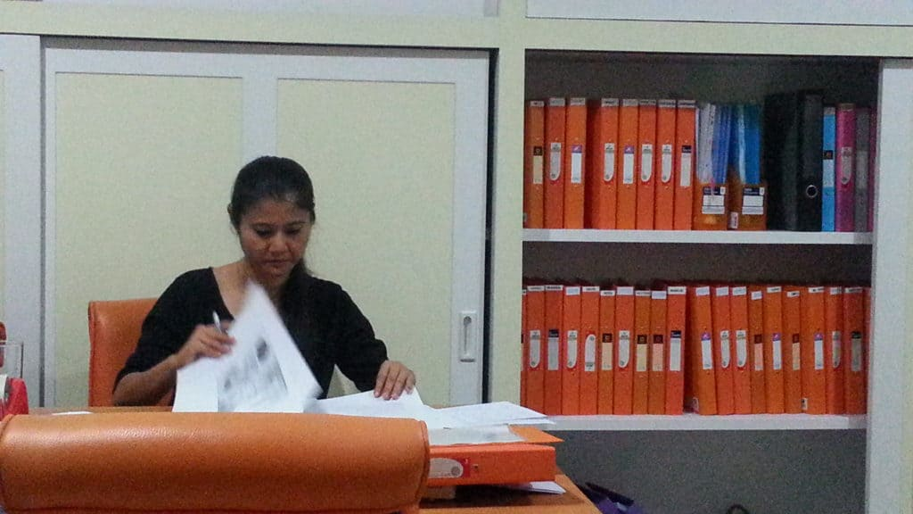 thai888 law office director at work checking on cases and following up on the paper trail before going to court. Civil Law